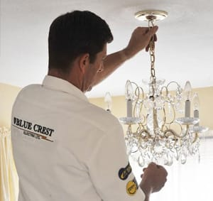 Electrician fixing light fixture.